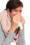 Woman with facial tissue having flu. - stock photo