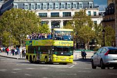Stock Photo of Yellow city sightseeing bus Neoplan on Paris city street.