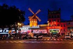 The Moulin Rouge by night in Paris, France Stock Photos