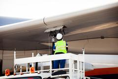 Refuelling the aircraft - stock photo
