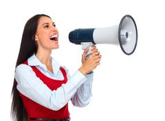 Young woman with loudspeaker. Stock Photos