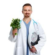Doctor with body scales and parsley. - stock photo