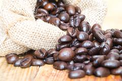 Coffee beans in sack closeup - stock photo