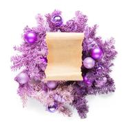 Magenta christmas wreath with parchment on white Stock Photos