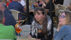 Tourists relaxing and talking at an outdoor restaurant in Prague Stock Footage