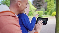 4K Cute little girl outdoors with her father video chatting to grandparents  Stock Footage