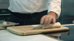 Chef putting the horseradishes on a cutting board Stock Footage