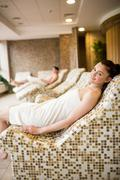 Couple relaxing in the thermal suite - stock photo