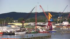 Industrial cranes in dockyard in Gothenburg Stock Footage