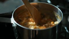 Cooking soup on stove. Slow Motion. - stock footage