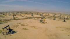 Amazing aerial shot over vast oil fields and derricks near Bakersfield, - stock footage