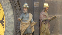 Men with turbans statues on Prague Astronomical Clock Stock Footage