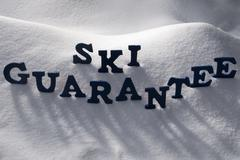 Blue Word Ski Guarantee On Snow Stock Photos