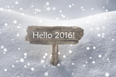 Stock Photo of Christmas Sign Snow And Snowflakes Hello 2016