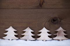 Four Wooden Christmas Trees On Snow, Copy Space, Advent Stock Photos