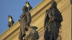Two men statues on Czech Philharmonic Orchestra House in Prague Stock Footage