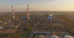 Huge industrial plant with pipes at sunset Stock Footage