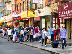 Tourists and chinese immigrants at Chinatown in New York City Stock Photos