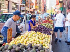 Chinese immigrants selling exotic fruits at Chinatown in New York City Stock Photos