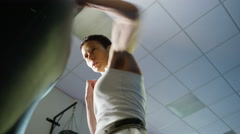 4K Female martial artist or boxer training with a punch bag at the gym - stock footage