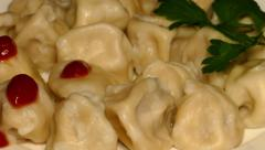 4k – Boiled meat dumplings with ketchup and parsley on plate 01 Stock Footage