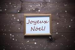 Picture Frame With Joyeux Noel Means Merry Christmas, Snowflakes - stock photo