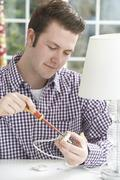 Man Wiring Electrical Plug On Lamp At Home Stock Photos