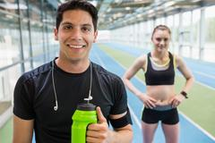 Stock Photo of Fit couple on the indoor track
