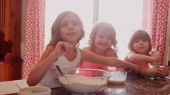 Little girls smiling and tasting cookie dough Stock Footage