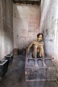 Model of Vietnamese prisoner - stock photo