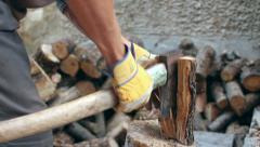 Man with gloves chopping wood Stock Footage