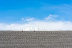 roof tiles with blue sky background - stock photo