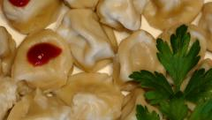 4k – Boiled meat dumplings with ketchup and parsley on plate 02 Stock Footage