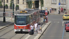Red and white tram leaving the tram station, Prague Stock Footage