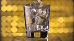 Pouring whiskey drink into glass Stock Footage