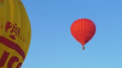 Hot air balloons flies into the blue sky at the Hot Air Balloon Festival Stock Footage