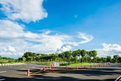 Roadside view of beautiful park on blue sky - stock photo