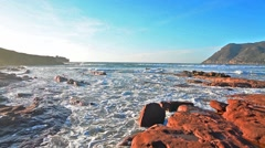 Red rocks in Porto Ferro coastline. Stock Footage