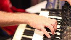 Piano player with synthesizer in action - stock footage