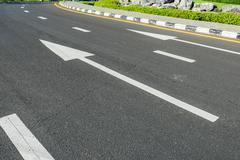 White arrow on Surface traffic - stock photo