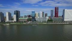 Aerials Rotterdam flight over river to city centre, river reflection in glass Stock Footage