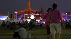 Lady and friend kite flying in the evening,Bangkok,Thailand Stock Footage