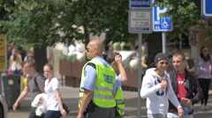 Police officers standing in the street in Prague Stock Footage