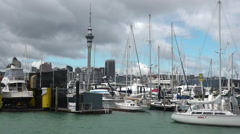 Westhaven marina against Auckland skyline New Zealand Stock Footage