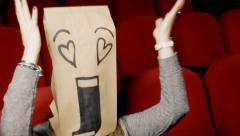 Breadbag face movie theater loving Stock Footage