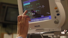 Nurse hand touching monitor close up Stock Footage