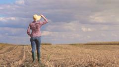 Female farmer walking on arable land Stock Footage