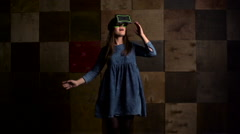 Virtual reality game. Girl uses head mounted display. Slow motion Stock Footage
