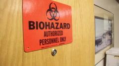 Biohazard ign on door - stock footage