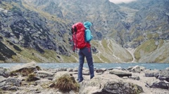 Hiker woman standing with hands up. Stabilized Slow Motion. Success concept. Stock Footage